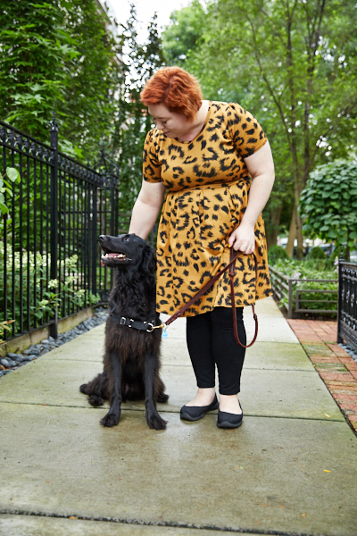 Equilibria Co-Founder Marcy Capron Vermillion and her dog, Leo, on the sidewalk