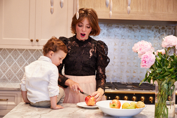Equilibria Co-Founder Coco Meers and her son cutting apples in the kitchen